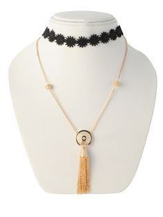 INR 700 This choker necklaces features a floral lace in black and is made with fabric. The delicate design makes it wearble and the metal clasps provide an adjustable fit.