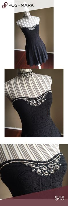"""🎀NEW LISTING🎀 Lace Dress w/Beaded Embellishment Black Lace Strapless Dress w/Beaded Embellishment by Free People. Size M. Layer of tulle peeks out below the lace hem. Loops to add straps if you want, straps not included with the dress. No slip strip in bust. Bust 30"""" lying flat, stretches to 36"""". Bust to hem length 27"""". Free People Dresses Strapless"""