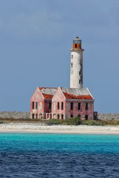 The Klein Curacao ('Little Curacao') lighthouse (1850) is 66 ft tall and powered by a solar powered LED light. The lighthouse sits on a .66 acre uninhibited island south east of Curacao.
