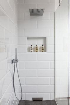 I love the simplicity of this shower. The white tile, the glass wall and door, the overhead rain fixture. Small Tile Shower, White Subway Tile Shower, Large Tile Bathroom, White Beveled Subway Tile, Tile Shower Niche, White Tile Backsplash, Subway Tile Showers, Bath Tiles, Master Bath Tile
