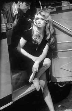 "Brigitte Bardot on ""Lady and Puppet"" set, resting at bus with actor Michel Roux. Loomis Dean—Time & Life Pictures/Getty Images"