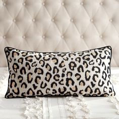 Bring wild style to your room with this elongated pillow, boasting a chic leopard look.