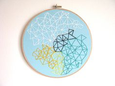 colorful geometric embroidery hoop art by lulu and hasil