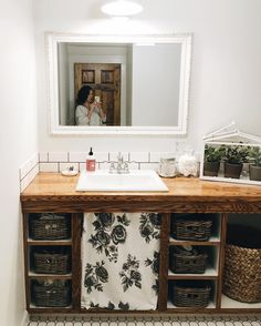 Please don't zoom in on me or the baskets over flowing with stuff.  I know this looks like bathroom selfie, but I tried to photograph this bathroom, but me ducking down and holding up the phone was even weirder.  This documents my success for this room being semi-clean.  Just sprayed some blue stuff in the toilet in hopes it will clean itself 🙏🏻. For those that have followed me for a while, I hope you get the joke 😜. And I wanted to show off this vanity the hubby made from left over oak…