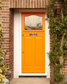 An Art Deco front door with striking stained glass details, incorporating a 'sunrise' design, polished chrome door furniture and a 'colour pop' finish. Bright Front Doors, Orange Front Doors, Orange Door, Yellow Doors, Front Door Colors, Art Deco Door, Stained Glass Door, Glass Front Door, Glass Doors