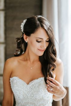Our Wedding – Kristen Williams, bride hair and make-up, neutral glam look, big curls swept to one side, bride getting ready photos