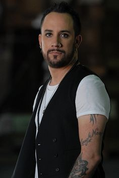 AJ McLean - I'm not much for the painted nails, overabundance of tattoos and eyeliner, but I do LOVE his voice. And he's kind of cute. ;)