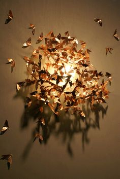 Lamp shade consisting of copper moths, by Katharina Mischer