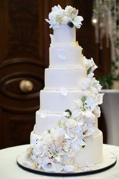 6 tier wedding cake with sugar flower cascade by elizabethscakeemporium, via Flickr