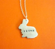 Show off your bunny love with this Mini Vegan Bunny Necklace! - Made of recycled aluminum - Pendant measures approximately x just under - Comes with mm sterling s Vegan Clothing, Ethical Clothing, Vegan Gifts, Vegan Fashion, Body Jewelry, Jewellery, Glass Jewelry, Handmade Jewelry, Bunny