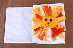 QUIET BOOK - lion: the mane is made up of different sorts of ribbons in different textures.