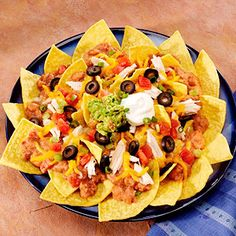 Crispy corn tortilla chips smothered with beans, chicken, and cheese and topped with tomatoes, green onions, and ripe olives.