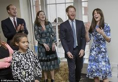 In hysterics: Prince Harry, Kate Middleton and Prince William laugh together at a 'welly wanging' contest in London last October