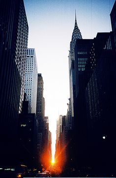 """Manhattanhenge"", the semi-annual occurrence where the setting sun aligns perfectly with east/west streets!"