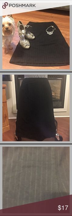 "Ann Taylor Loft Petites Wool Pinstripe Skirt Black pinstripe Ann Taylor Loft Petites skirt, size 2P.  96% wool, 4% Lycra spandex.  Lining is 100% acetate.  26"" long, 13.5"" across the waist.  In great pre-owned condition! LOFT Skirts Midi"