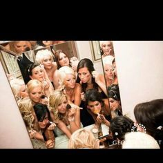 Bride and bridesmaids getting ready for wedding. Wedding photo ideas
