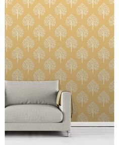 This Annabelle Tree Wallpaper has a stylish tree pattern in white with touches of grey on a matte mustard yellow background. Free UK delivery available Tree Themed Wallpaper, Wall Wallpaper, Mustard Wallpaper, Touch Of Gray, Terraced House, Gray Bedroom, Living Room Grey, Yellow Background, Free Uk