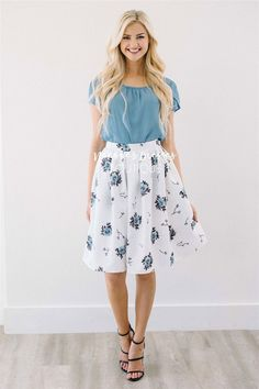 This skirt is oh-so-beautiful and so much more! It was love at first sight when we saw it and we know it will be for you too. Full white skirt features a light blue floral print, and a pleated waist