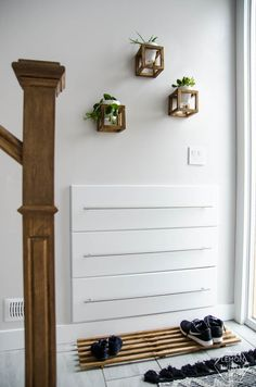 DIY Split Level Entry Makeover- I LOVE this entry. The oversize door, scandi influence and that shoe storage! Split Level Entryway, Split Foyer, Home Renovation, Home Remodeling, Bathroom Remodeling, Bathroom Ideas, Split Entry Remodel, Entryway Shoe Storage, Entryway Organization