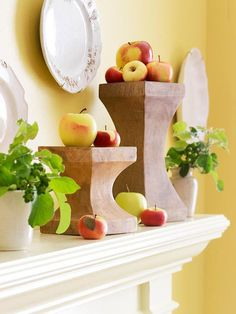 Arrange brightly colored apples on your mantel, perching them on decorative urns for height. Use artificial apples if you want the display to last the whole fall season.
