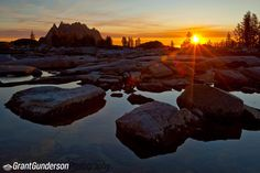 Morning alpenglow and sunrise over Prusik peak and the enchantments in the Alpine lakes Wilderness Order prints at: prints.grantgunderson.com