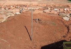 My first attempt in building my KeyHole Garden. Cleared out space and after finding loads of rocks, I then measured 6 ft string and tied it to two sticks and traced this circle outline. For more info on how to build a Keyhole Garden check out this video http://www.youtube.com/watch?v=ykCXfjzfaco  or check out these guys http://www.valhalla-project.com/2012/01/from-africa-to-valhalla-keyhole-garden.html