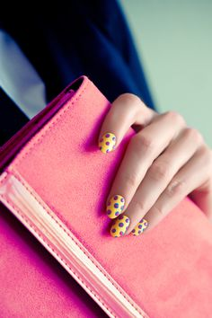 Funky pop art nails and pink clutch. Perfect to pair with monochrome to add a colour pop.