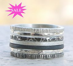 This silver rings set of 7 is made of sterling silver wire, 1,4mm width. Sterling silver bands, hammered and also black oxidized rings. Regular price for this set:80$ A discount of 15% has been made, so no coupon code is needed! This listing of skinny rings set refers to the following silver rings bands.: 1. Rustic texture, matte finish. 2. Silver polished. 3. Hammered, with slight oxidation. 4. Rough texture 5. Rough texture and black oxidation. 6. Hammered and polished. 7.Rustic texture…