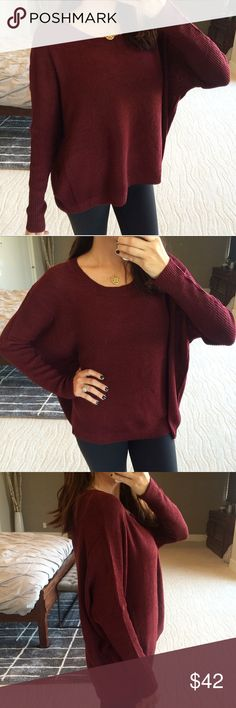 "New! Burgundy ribbed knit sweater Reach those fall outfit goals with the perfect knit sweater.  Features a round neckline, drop shoulders, asymmetrical hem, and an oversized fit. Light weight, cotton/acrylic blend. I'm 5'5"" size 2 modeling a S/M. No trades. No offers, price is firm. Stock is limited! Sweaters"