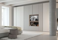 Download the catalogue and request prices of Grafik | wardrobe with built-in tv By caccaro, contemporary style sectional lacquered wooden wardrobe with built-in tv design Sandi Renko, swing Collection
