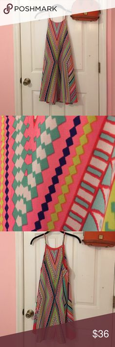 NWT Neon Tribal Print dress Brand new neon tribal print dress, adjustable straps, above knee, lined, available in sizes small, medium, and large! Fashionomics Dresses Midi