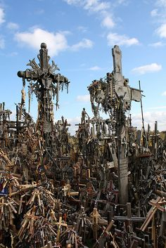 Lithuania's Haunting Hill of Crosses ~ Outside the city of Šiauliai, Lithuania, there's an area covered with an estimated 55,000 crosses. They are memorials to Lithuanian patriots who died in campaign after campaign to free the nation from various occupying forces. The crosses have been bulldozed several times, but spring back starting immediately afterward.