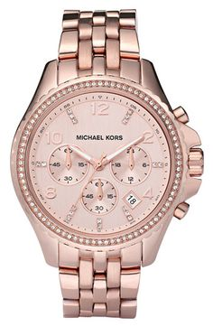 MK 'Pilot' Watch - $278.65  Sparkling crystals rim a round, oversized case on a show-stopping watch. Function meets fashion as the mother-of-pearl dial provides a polished backdrop to a three-eye chronograph feature and date window.  Approx. band length: 190mm.  Approx. band width: 20mm.  Approx. case diameter: 44mm.  Rose gold-plated stainless steel/Swarovski crystals/mother-of-pearl.