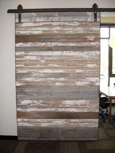 reclaimed lumber sliding barn door... I like!!