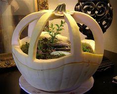 Miniature garden in a pumpkin - click through to see their spooky Halloween version, too.   The Mini Garden Guru