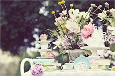 Whimsical spring wedding centerpieces with beautiful pastel flowers arranged with teacups.