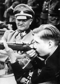 "The notorious SS-Obergruppenführer und General der Waffen-SS Josef ""Sepp"" Dietrich is seen here at Innsbruck in October 1943 at a visit to a shooting match organized by the Hitlerjugend. Around his neck the famous Waffen-SS commander wears the Knight's Cross with Oak Leaves and Swords."
