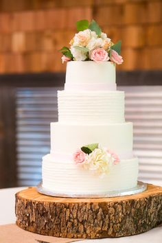 The Cake Four tiers of alternating smooth and textured icingsimple and sweet Photo byAllison Davis Photography Cake by Sweet Art Bakery - Project Wedding