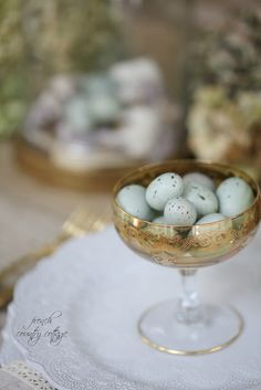 These are craft store eggs- but for an edible treat for your guests think Jordan Almonds or spreckled eggs candy in small dishes at each place setting - which is sure to delight.