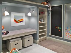 Playroom: built in Lego/activity table with drawers for Lego storage, storage ottoman seats on casters, between built in shelves.  I also love the framed chalk and magnet boards on the far wall!