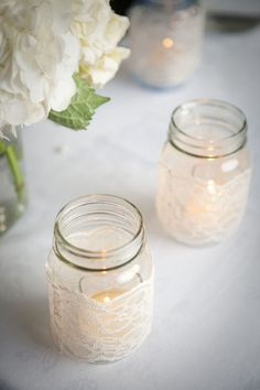 Lace wrapped Mason jars create the perfect mood lighting for an evening reception. Mason jars, lights and candles will be everywhere at my wedding. Pot Mason Diy, Lace Mason Jars, Mason Jar Candles, Mason Jar Crafts, Lace Candles, Candels, Votive Candles, Mason Jar Candle Holders, Floating Candle