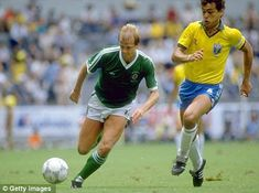 Toughest of tests: Northern Ireland's Colin Clarke under pressure from Edhino in their 1986 World Cup clash with Brazil