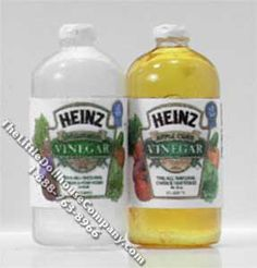 "These miniature replica bottles of white and cider vinegar are perfect for your dollhouse. the bottles have been created to include realistic miniature replica labels. Dimensions: 1/4"" diameter x 11/16"" tall. Functionality: Do not drink."