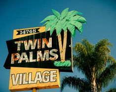 Twin Palms Village neon sign