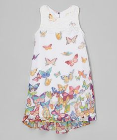 White Butterflies Dress w/lace overlay at neckline. I love how the butterfly print goes from a few to many as you get closer to the hem. Simple yet really pretty.