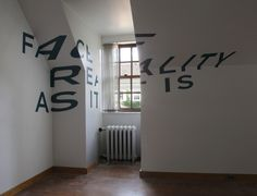 """Chicago-based graphic designer Thomas Quinn created this optical illusion on the blank walls of the room above his parents' garage. Using a simple sans serif font, Quinn figured out exact shapes and distortions for each letter, making a completed phrase appear perfectly aligned from only one certain point in the room. When viewers move around, they will find that the anamorphic typography actually looks stretched out and warped, and the message is broken from any other angle."""