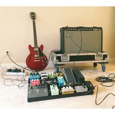 @Anthony Uriarte-Gamez's pedal board, amp and guitar.