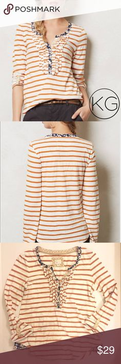 """Anthropologie Ruffled Striped Henley by Postmark In excellent pre-owned condition! •Women's size X-Small •Burnt orange striped top with dark blue floral inlays •16.5"""" from underarm to underarm, 24"""" from shoulder to hem •Long sleeved, but can roll up to 3/4 sleeves with button tabs •72% Cotton, 28% Polyester •Retail $58 no trades nor lowball offers Thank you for shopping in my closet! Anthropologie Tops Tees - Long Sleeve"""