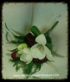 white freesia with red spray roses buttonhole www.weddingflowersbylaura.com