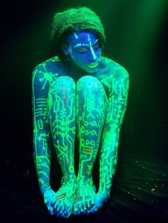 Second Blacklight / UV shoot with Jinx LaRue.    Assistant lighting and body art help by Deuce.